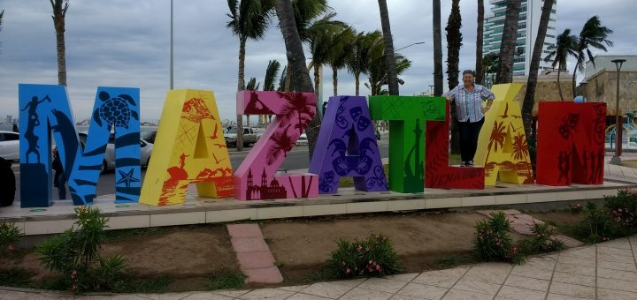Ana posing with Mazatlan word sculpture