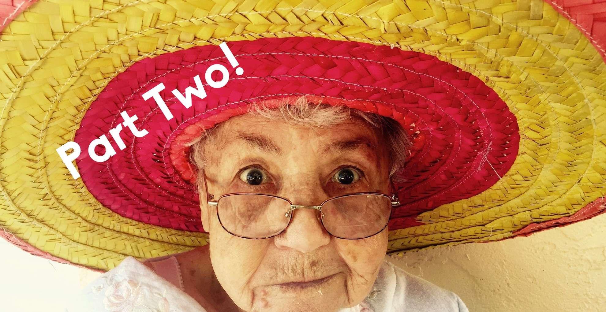 Old woman with a big yellow and red hat