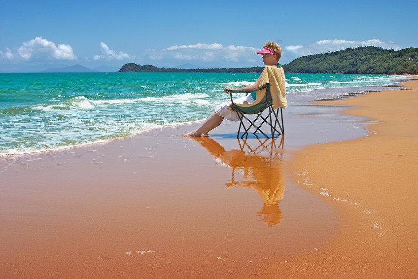 woman in a chair on a beach